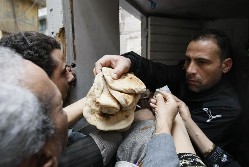 Egyptians gather to buy bread in Central Cairo in January 31, 2011, during anti-government protests.