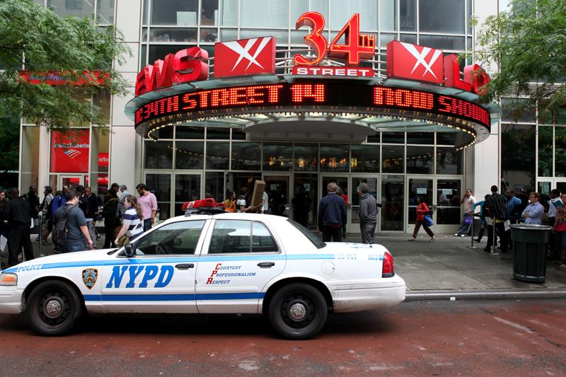 "Extra police are outside of New York City movie theaters on opening night of ""The Dark Knight Rises."""