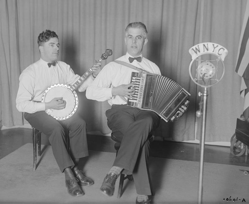 The Flanagan Brothers performing in the WNYC studio, December 9, 1926. Mike is on banjo while Joe plays the accordion.