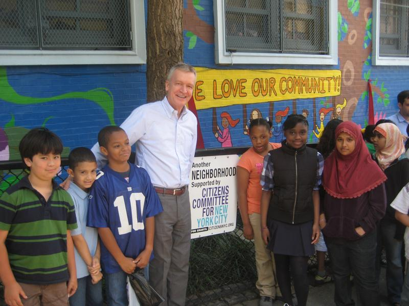 Peter Kostmayer, head of Citizens Committee for N.Y.C., visits a community project.