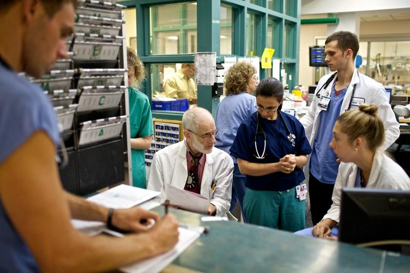 Dr. Lewis Goldfrank (center) discusses a patient with medical residents.