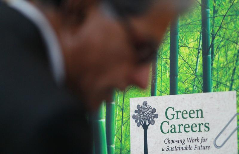 A job seeker looks through green job pamphlets at the Green Jobs and Entrepeneurship Fair on February 16, 2011 in Berkeley, California.