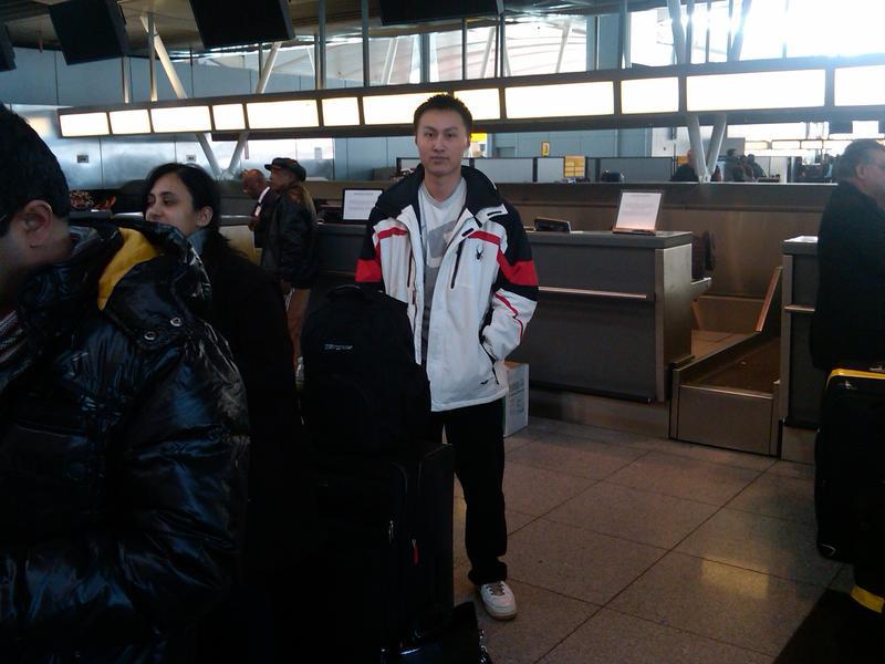 Traveler waiting in line at JFK Airport.