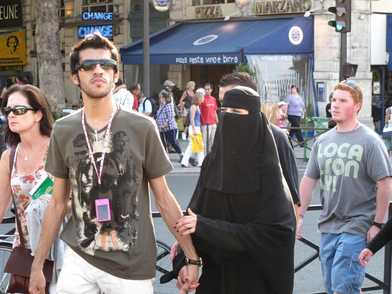 A woman wearing a burqa and her male companion in Paris, France in July 2010.