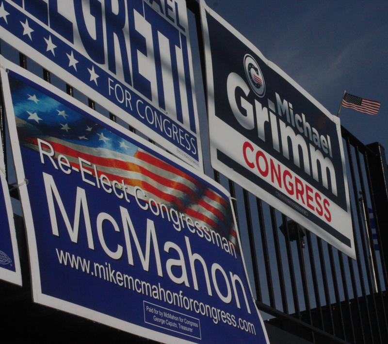 Campaign signs for Congressman Mike McMahon and his challenger, Michael Grimm, in Staten Island.