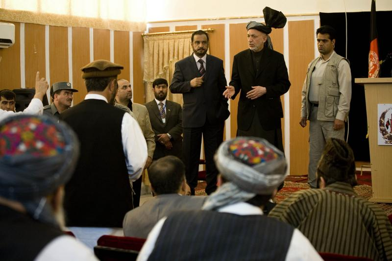 Afghan President Hamid Karzai talks during a meeting with elders in Kunduz, Afghanistan.