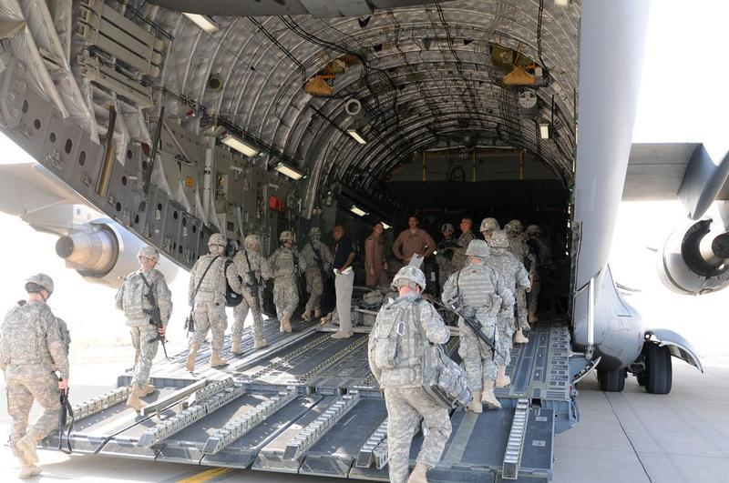 The flight crew of a C-17 oversees the boarding of soldiers from 3rd Infantry Division at Contingency Operating Base Speicher, Iraq, Aug. 23.