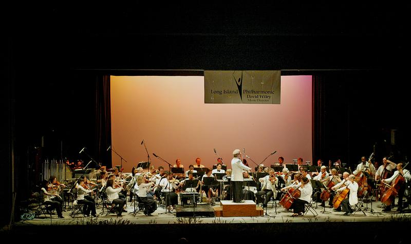 The Long Island Philharmonic performs an outdoor concert.