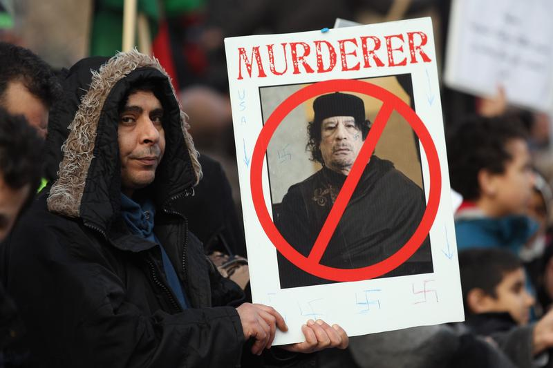 Demonstrators opposed to the regime of Libyan leader Col Muammar Qaddafi gather in Hyde Park on February 17, 2011 in London, England.