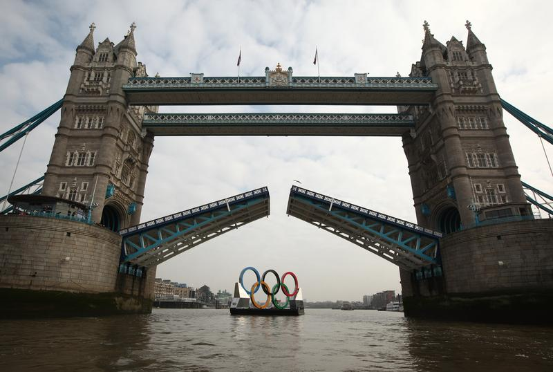 Giant Olympic rings floating down the River Thames