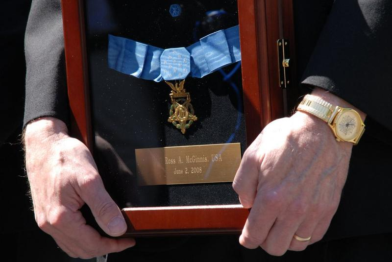 Tom McGinnis, father of posthumous Medal of Honor recipient Spc. Ross McGinnis, displayed his son's medal with pride following a White House ceremony.