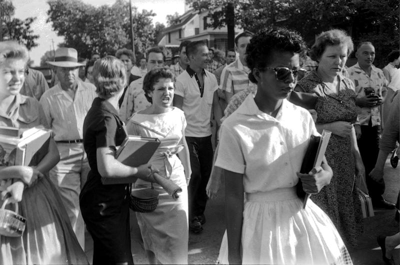 Elizabeth Eckford, followed by an angry crowd after she was denied entrance to Little Rock Central High School, September 4, 1957. The girl in the light dress behind her is Hazel Bryan.