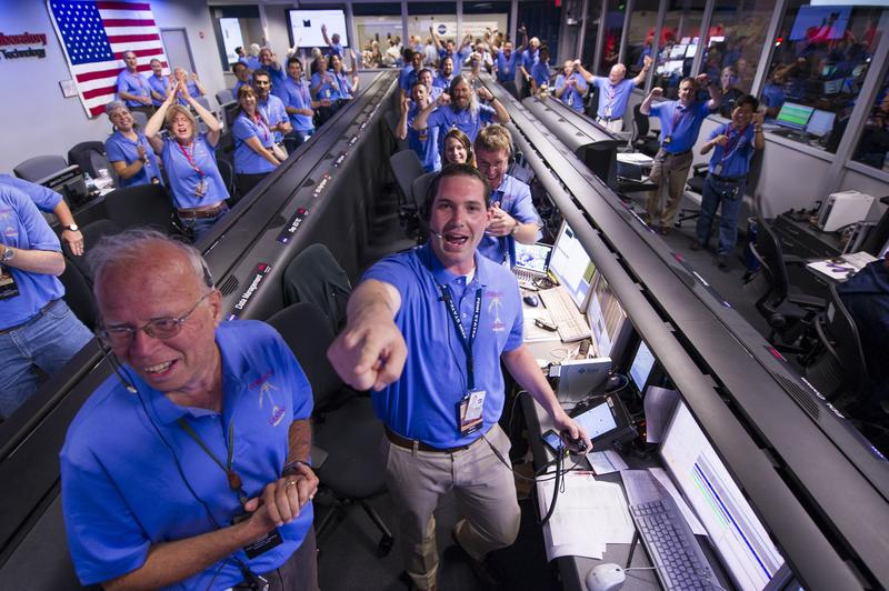 NASA/JPL ground controllers react to learning the the Curiosity rover had landed safely on Mars.