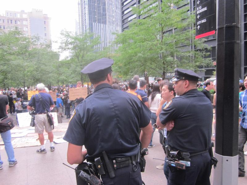 Police watching over the demonstrators in Zuccotti Park