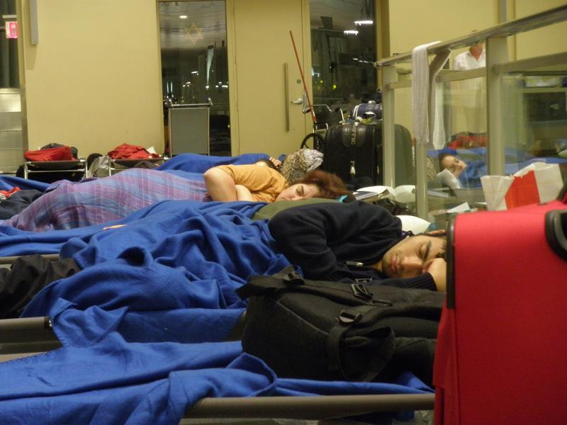 Stranded passengers sleep at JFK International Airport.