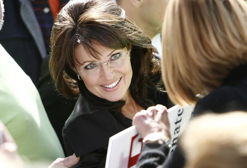 Former vice-presidential candidate Sarah Palin greats supporters during a rally for Republican John Raese's U.S. Senate campaign October 30, 2010 in Charleston, West Virginia.