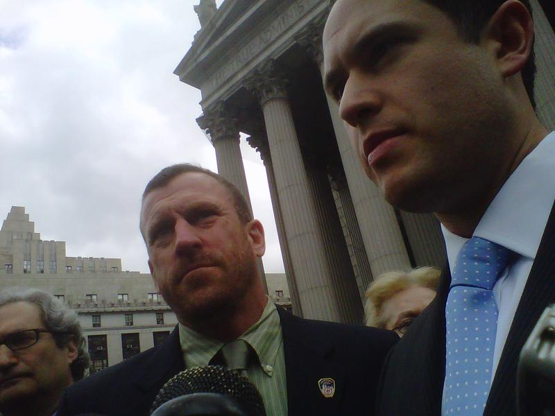 Attorneys Jack Lester (left) and Brett Joshpe flank Timothy Brown, a firefighter and the plaintiff in the lawsuit, outside State Supreme Court