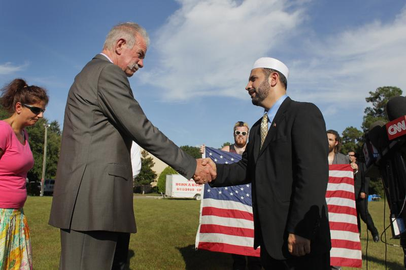 Dove World Outreach Center pastor Terry Jones (L) shakes hands with Imam Muhammad Musri, president of the Islamic Society of Central Florida in Orlando.