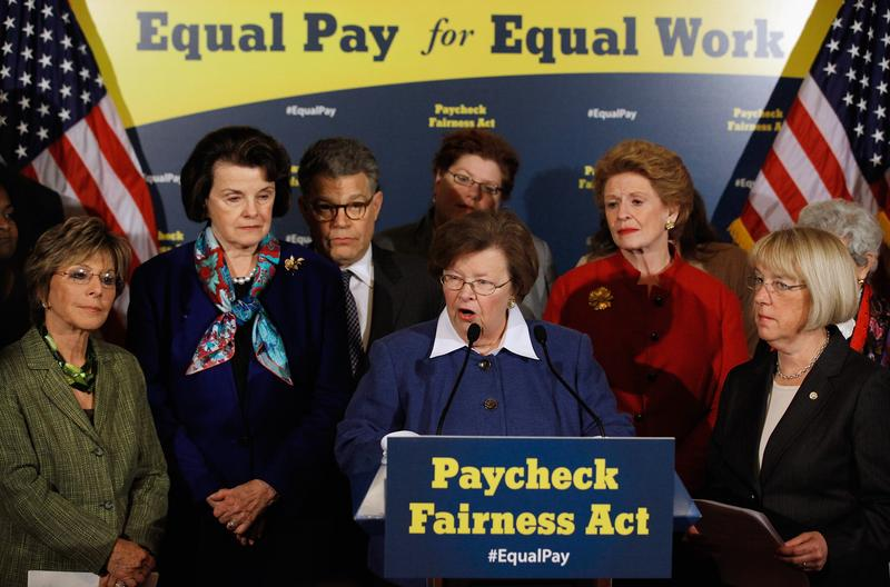 Democratic Senators rally around the Paycheck Fairness Act in a news conference on May 23, 2012.