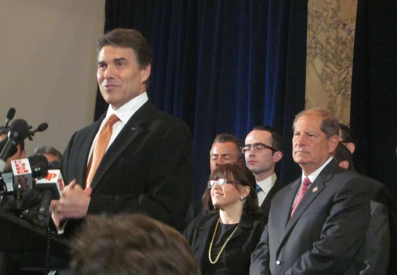 Texas Gov. Rick Perry criticizes Obama's policy on Israel at a New York press conference while newly-elected Rep. Bob Turner (R-NY) looks on.