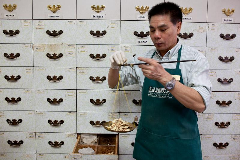 Preparing Chinese medicine prescriptions at Kamwo Herbal Pharmacy on Grand Street in Manhattan.
