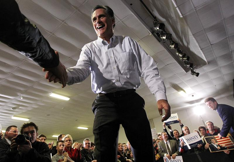 Republican presidential hopeful former Massachusetts Gov. Mitt Romney greets supporters during a campaign rally on January 9, 2012 in Bedford, New Hampshire.