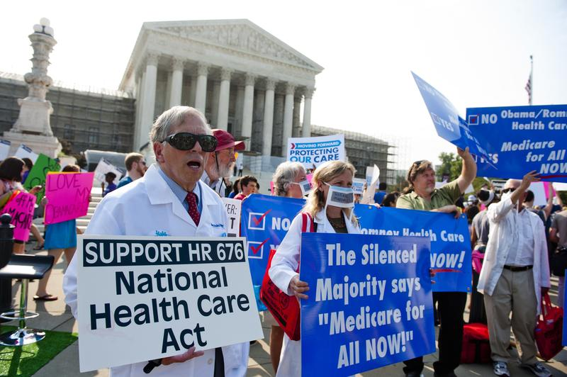 Demonstrators protest as they await a decision by the US Supreme Court on the constitutionality of the Affordable Healthcare Act.