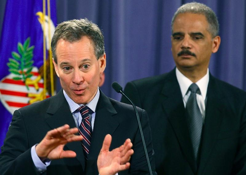 New York Attorney General Eric Schneiderman (L) speaks whille Attorney General Eric Holder listens during a news conference at the Justice Department on January 27, 2012 in Washington, DC.