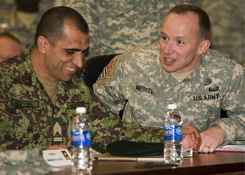 Afghan Sgt. Maj. of the Army Safi Roshan, left, talks with 205th Infantry Brigade Commander Col. Steven Merkel.