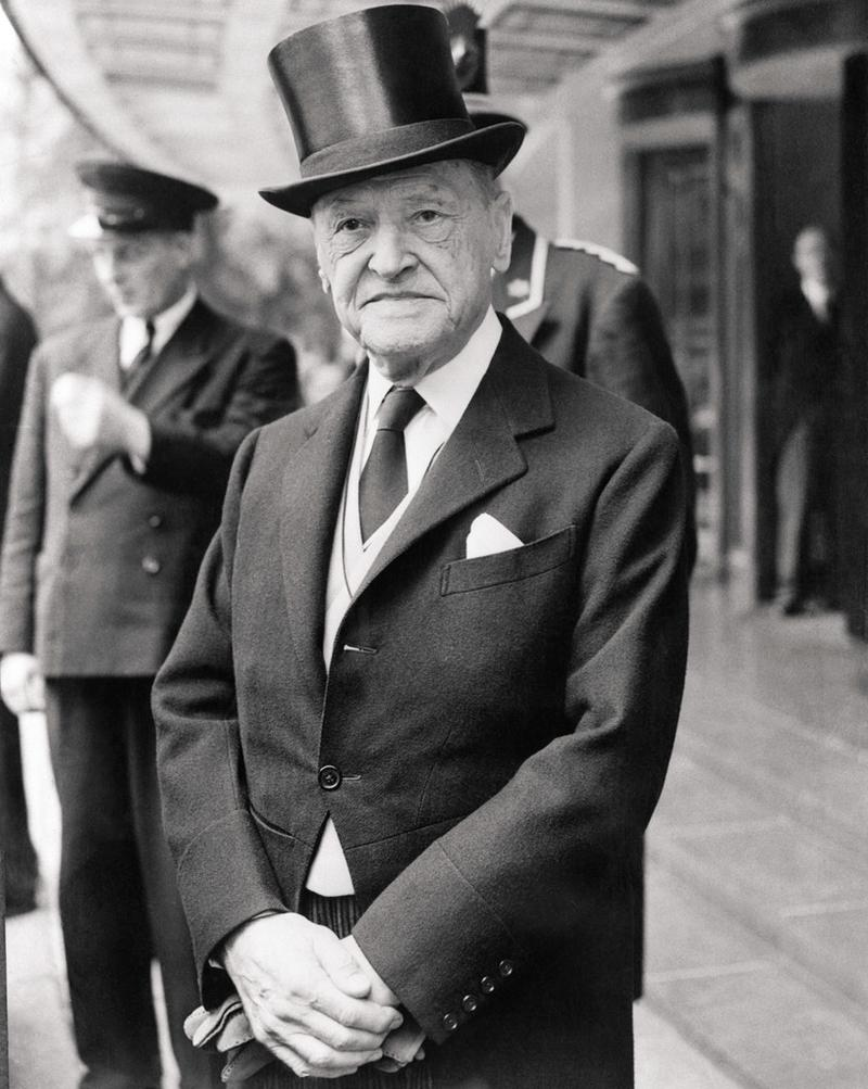 W. Somerset Maugham, leaving the Dorchester Hotel to attend a private investiture at Buckingham Palace, July 14, 1954.