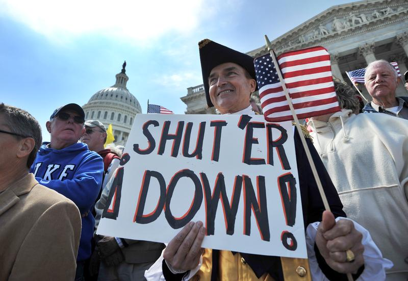 Protesters demonstrate in front of the Capitol Hill in Washington, DC, on April 6, 2011 urging for government spending cut.