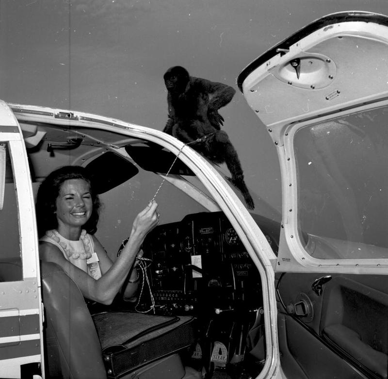 June Douglas with her flight mascot, Barefoot, prior to setting out on a 1,468 mile race. May 26, 1965.
