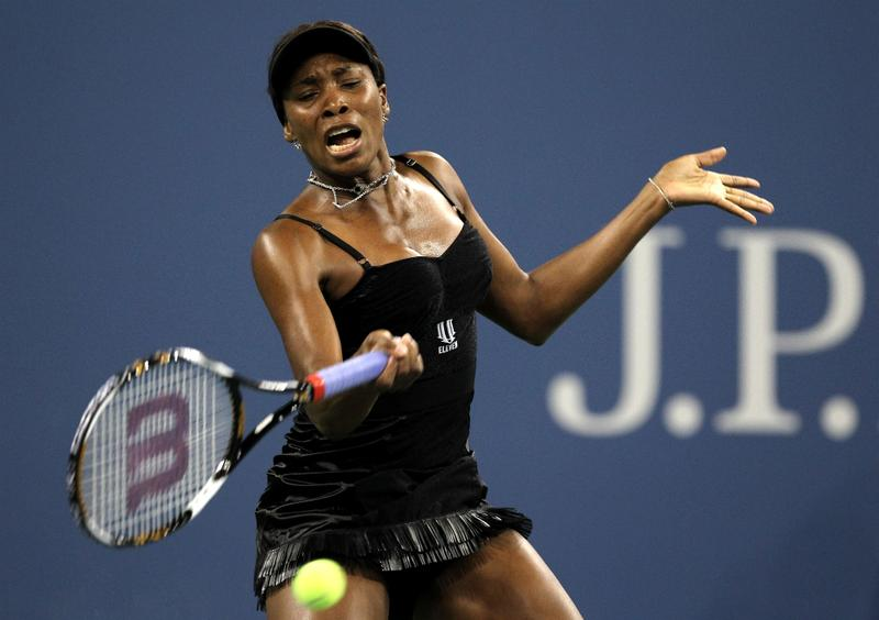 Venus Williams of the United States returns a forehand against Roberta Vinci of Italy during the Women's Singles first round match on day one of the 2010 U.S. Open.