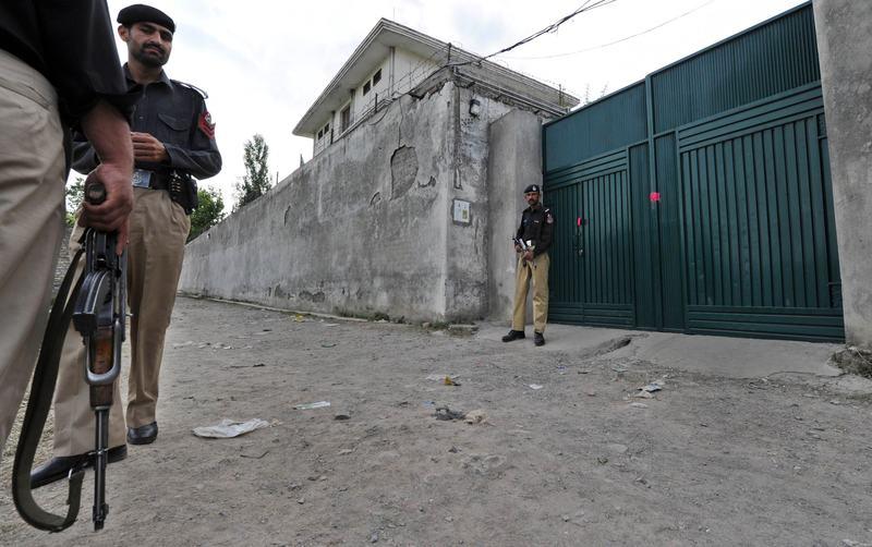 Pakistani policemen stand guard outside the hideout house of slain Al-Qaeda leader Osama bin Laden in Abbottabad on May 5, 2011