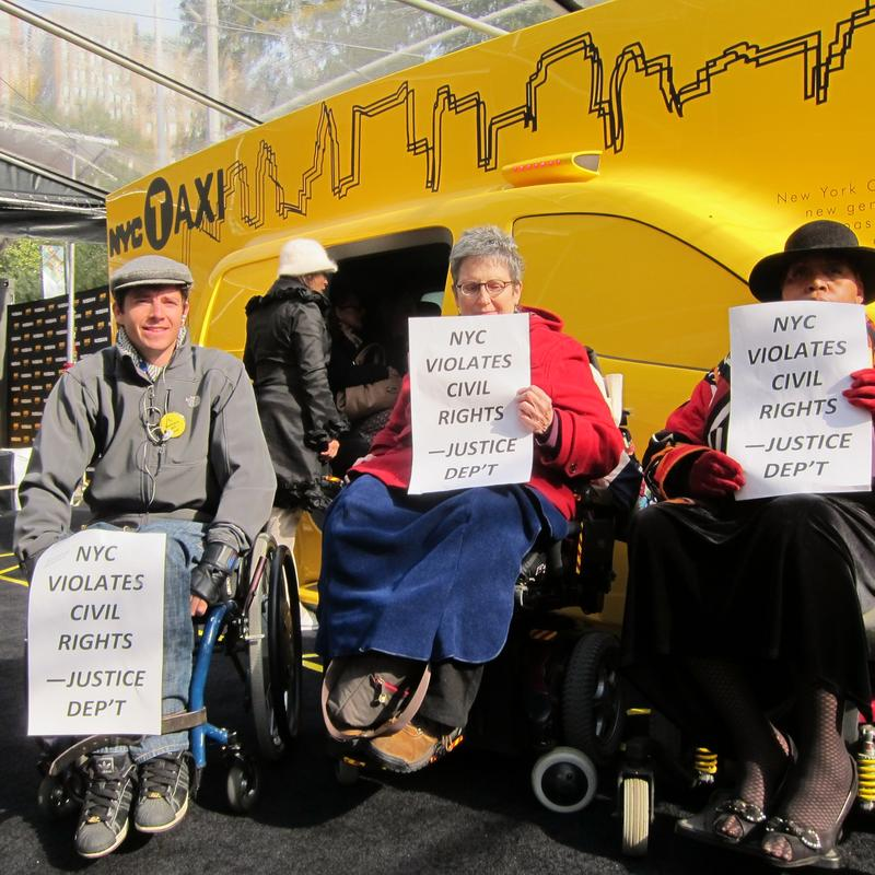 David McCauley, Jean Ryan and Sharona Jones protest the lack of accessibility in the 'Taxi of Tomorrow' demo model.