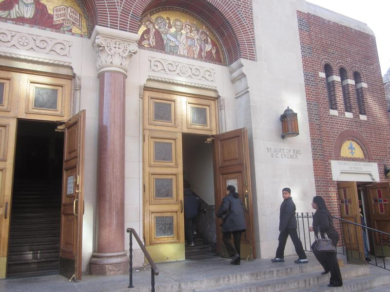 Worshipers enter St. Joan of Arc church