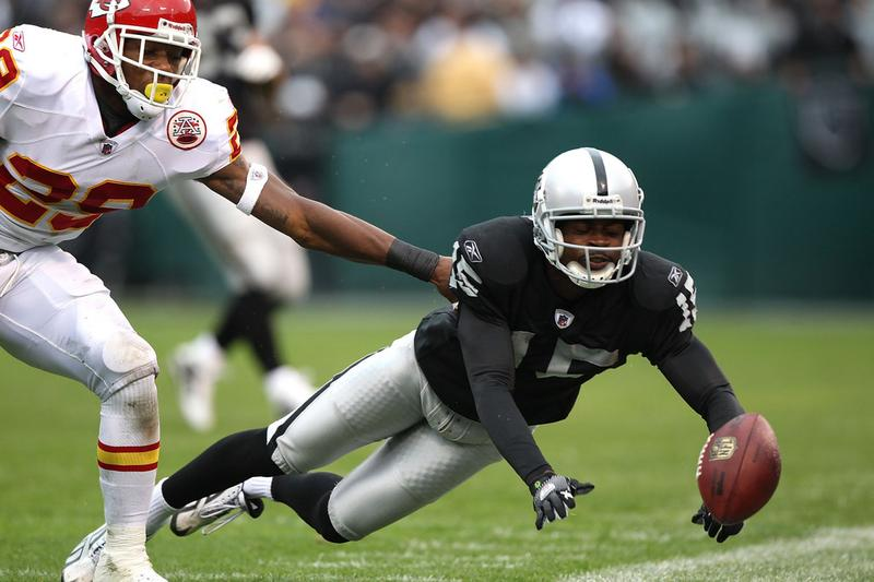 Johnnie Lee Higgins #15 of the Oakland Raiders misses a pass against Eric Berry #29 of the Kansas City Chiefs during an NFL game at Oakland-Alameda County Coliseum on November 7, 2010.
