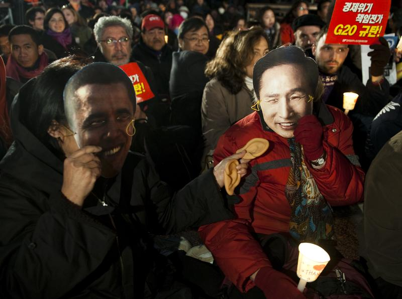 Anti-G20 protesters hold masks of U.S president Barack Obama and South Korea's President Lee Myung-bak as they gather on November 10, 2010 in central Seoul, South Korea.
