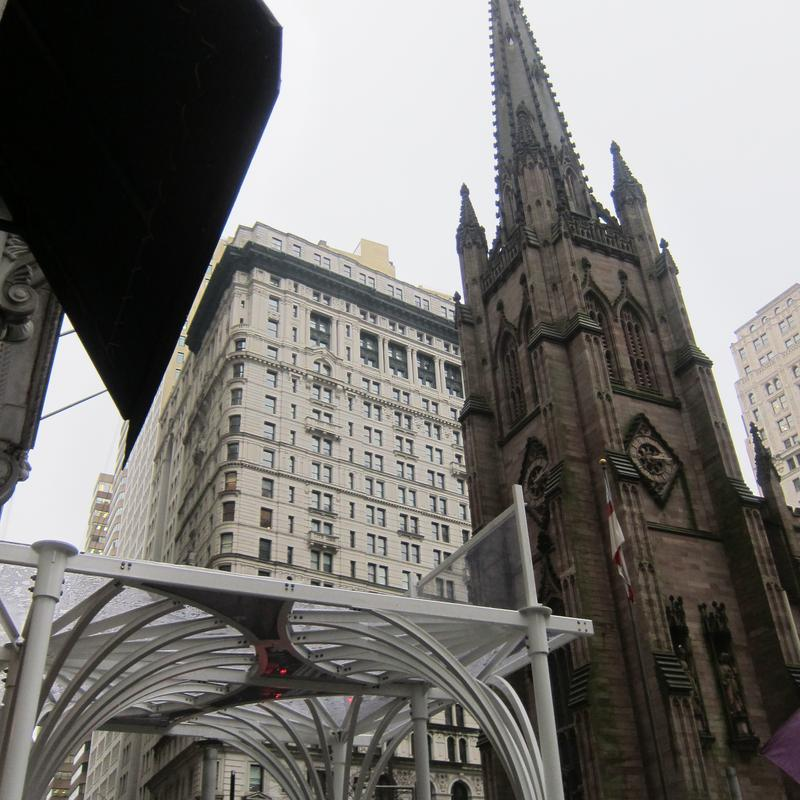 The Trinity Church steeple across the street from the sidewalk shed prototype.