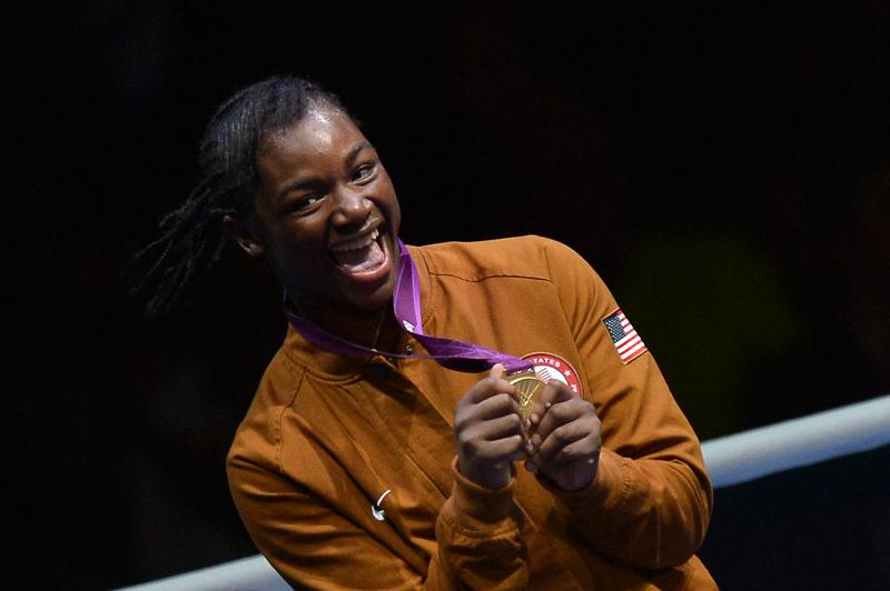 Gold medalist Claressa Shields of the USA celebrates with the gold medal on the podium.
