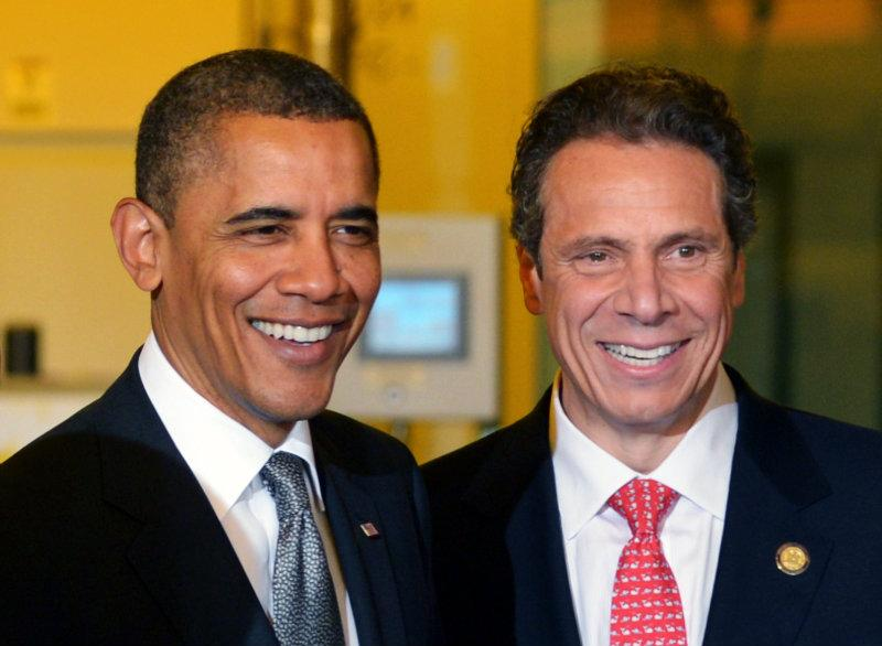 US President Barack Obama smiles with New York Governor Andrew Cuomo (R) during a tour of the of Nanoscale Science and Engineering's (CNSE) Albany NanoTech Complex at SUNY