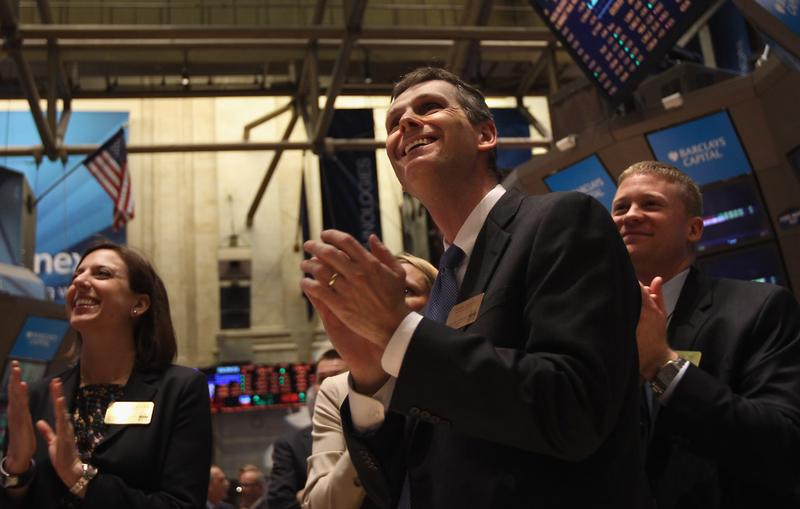 Applause breaks out at the New York Stock Exchange at the closing bell on February 21, 2012 in New York City. The Dow Jones industrial average broke through the 13,000 barrier.