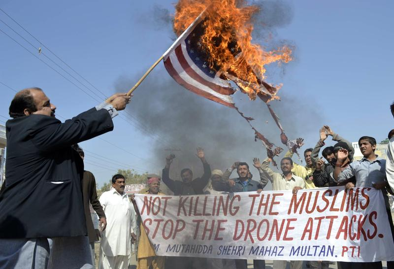 A Pakistani protester holds a burning US flag during a protest on February 9, 2012 against the US drone attacks in the Pakistani tribal region.