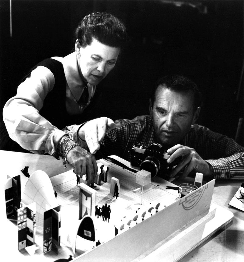 "Ray and Charles Eames photographing an early model of the exhibition ""Mathematica: A World of Numbers...and Beyond, 1960"