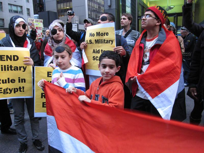About 75 Egyptian Americans and their supporters gathered in midtown to protest against an investment firm that owns the majority shares of a company selling tear gas to the Egyptian military.