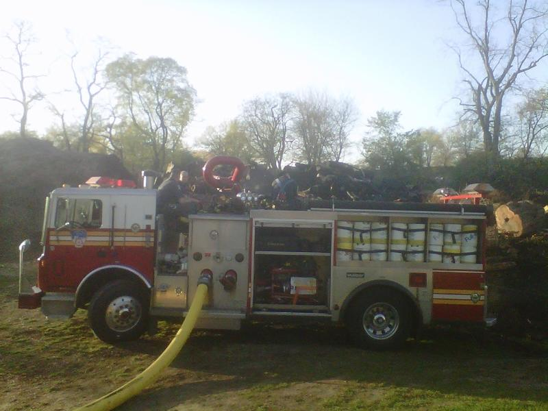 A firetruck in front of the smoldering remains of the fire in Central Park.