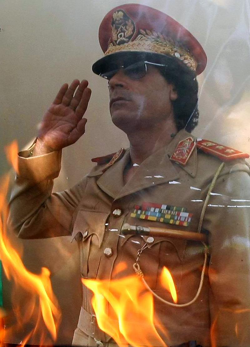 Close up of a portrait of Libyan leader Moammar Gadhafi set on fire by demonstrators during a protest outside the Libyan embassy in Ankara on August 22, 2011.
