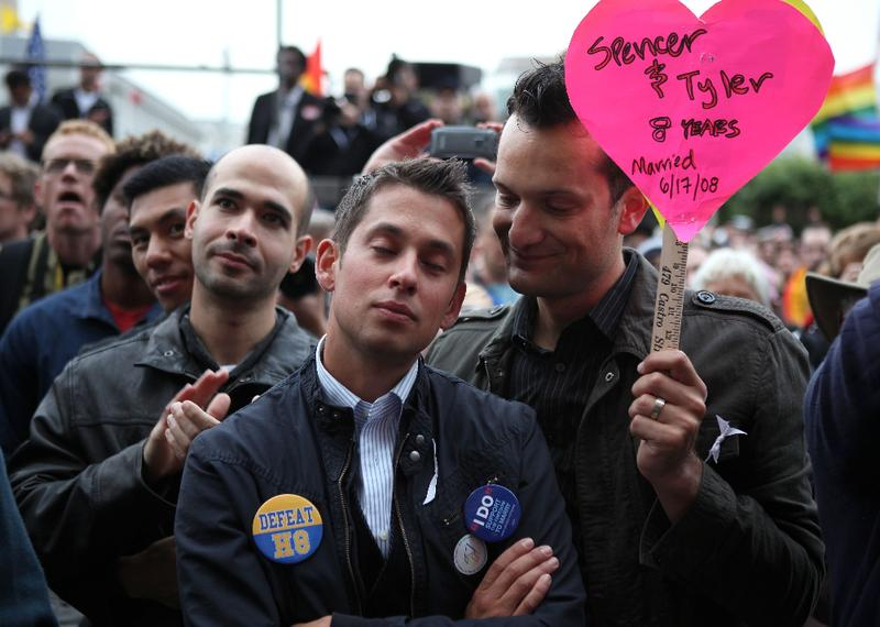 Spencer Jones looks on as his husband Tyler Barrick cries during a rally to celebrate the ruling to overturn Proposition 8 August 4, 2010 in San Francisco, California.