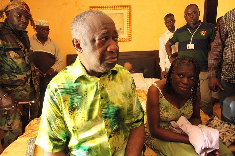 Ivory Coast strongman Laurent Gbagbo and his wife Simone sit on a bed at the Hotel du Golf in Abidjan after their arrest on April 11, 2011