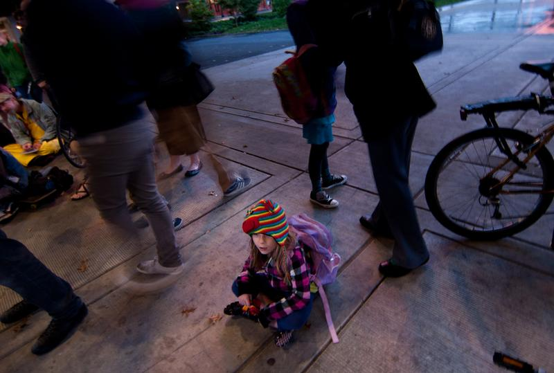 A girl looks on at an Occupy meeting in Portland, Oregon.